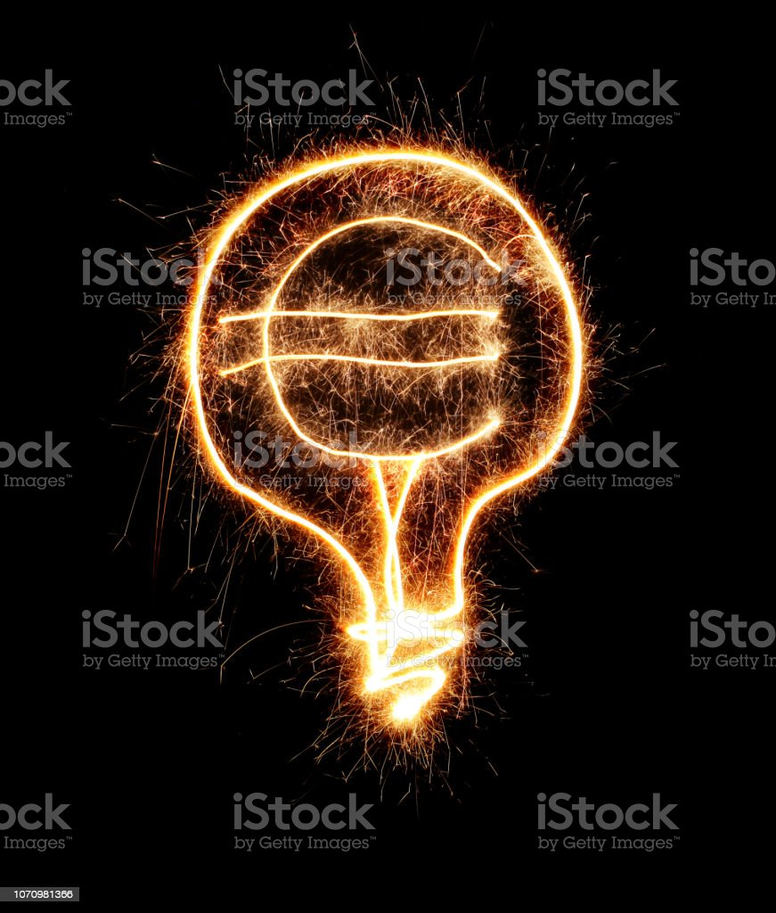 Light bulb with euro sign made from sparkler on black background and...