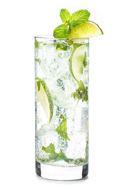 Sparkling Mojito on White Mojito cocktail in pint glass isolated on white background with mint and lime wedge garnish mojito stock pictures, royalty-free photos & images