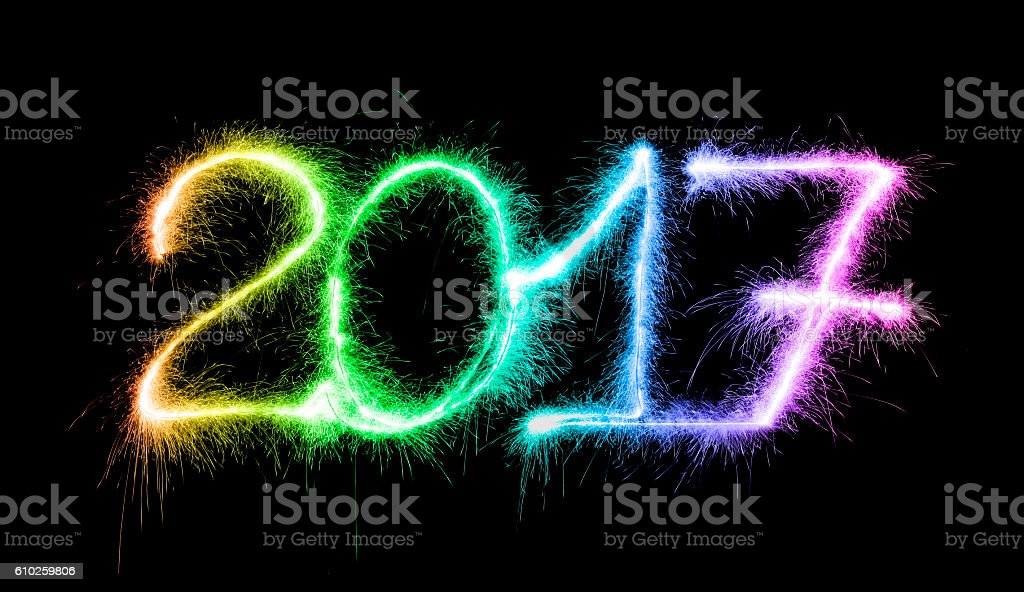 Sparkling multi colored 2017 written on a pure black background. The...