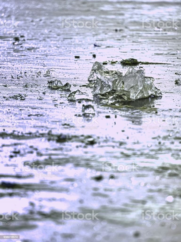 sparkling shards of cracked ice jut out on the frozen lake. The light effect occurs stock photo