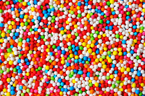 close up colorful texture of sparkling sugar bead background