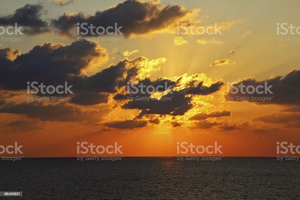 Sparkling sunset above sea royalty-free stock photo
