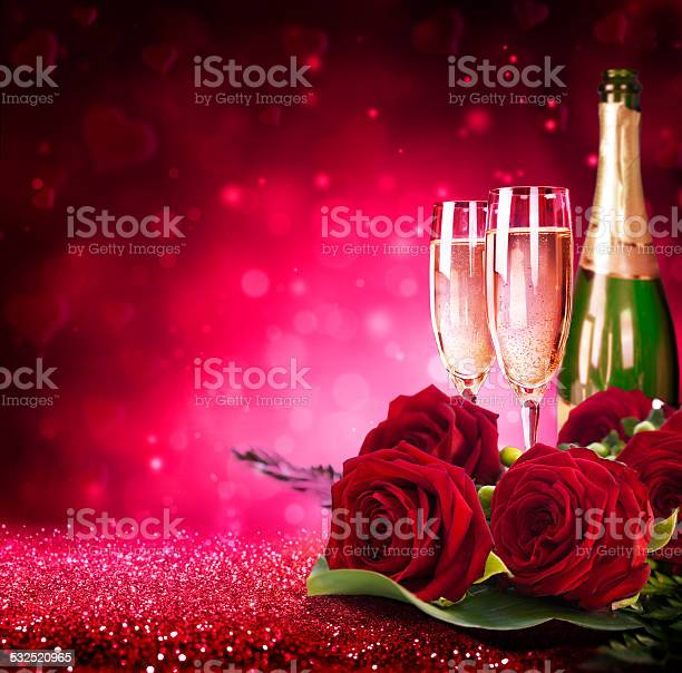 Sparkling valentines day flutes of champagne and red roses picture id532520965?b=1&k=6&m=532520965&s=612x612&h=8moilgmws07tibsczikjpugx8imb95sqy0qee4b lgw=
