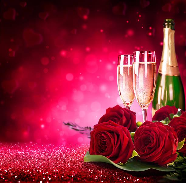 Sparkling valentines day flutes of champagne and red roses picture id532520965?b=1&k=6&m=532520965&s=612x612&w=0&h=6e0zsaw4uoikzmopklhzqmtmlnezslmtzhqzqd92ypk=