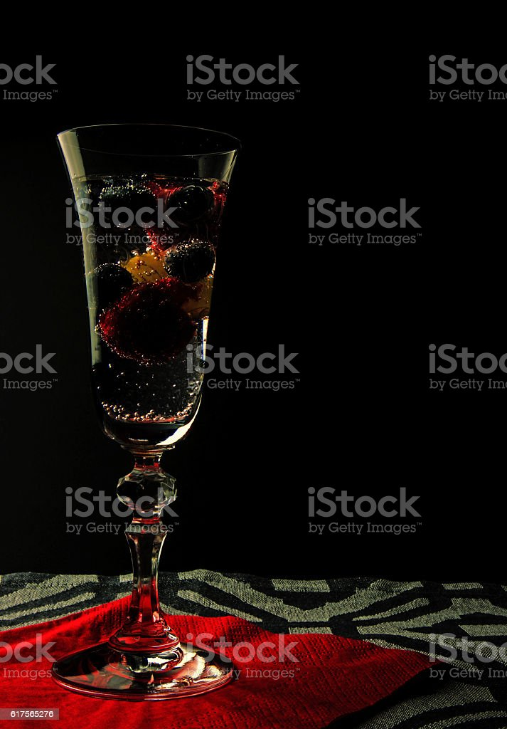 Sparkling water with fruit in a glass stock photo