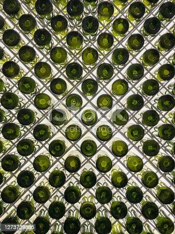 Sparkling wine bottles. Diagonal pattern on the lightbox