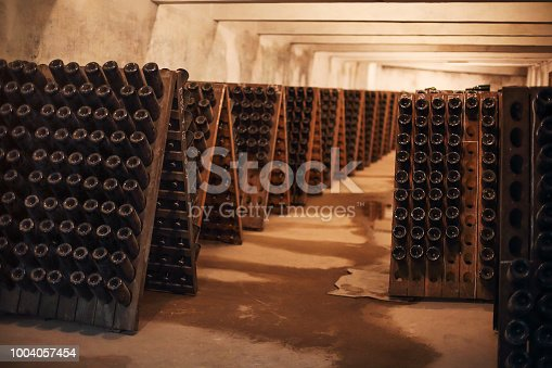 Sparkling wine glass bottles fermenting in winery