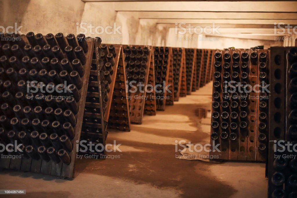 Sparkling wine glass bottles in winery stock photo
