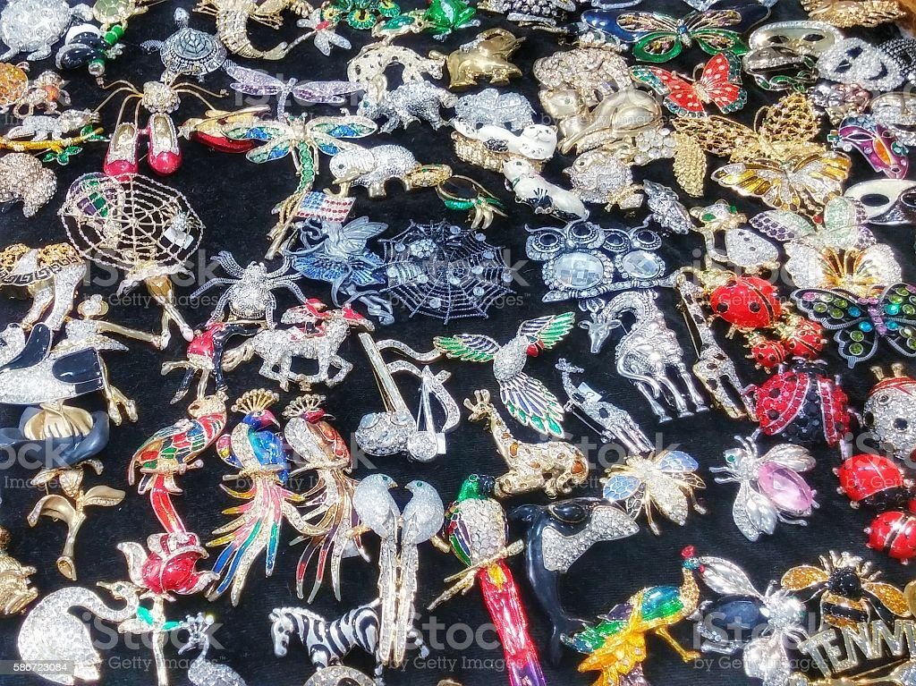 Sparkly Gawdy Broach Jewelry Pins on Black Felt For Display stock photo