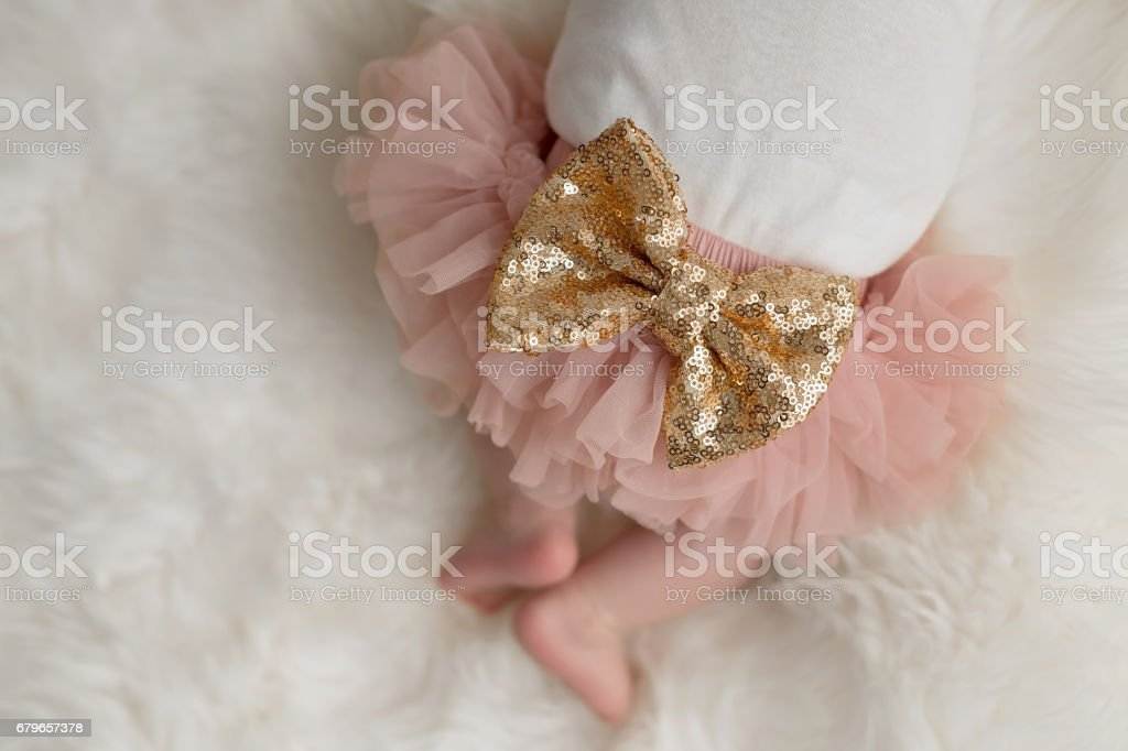 Sparkly Sequin Bow on a Baby Girl's Bottom stock photo