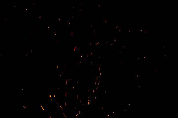 sparks and fire on a black background - particles imagens e fotografias de stock
