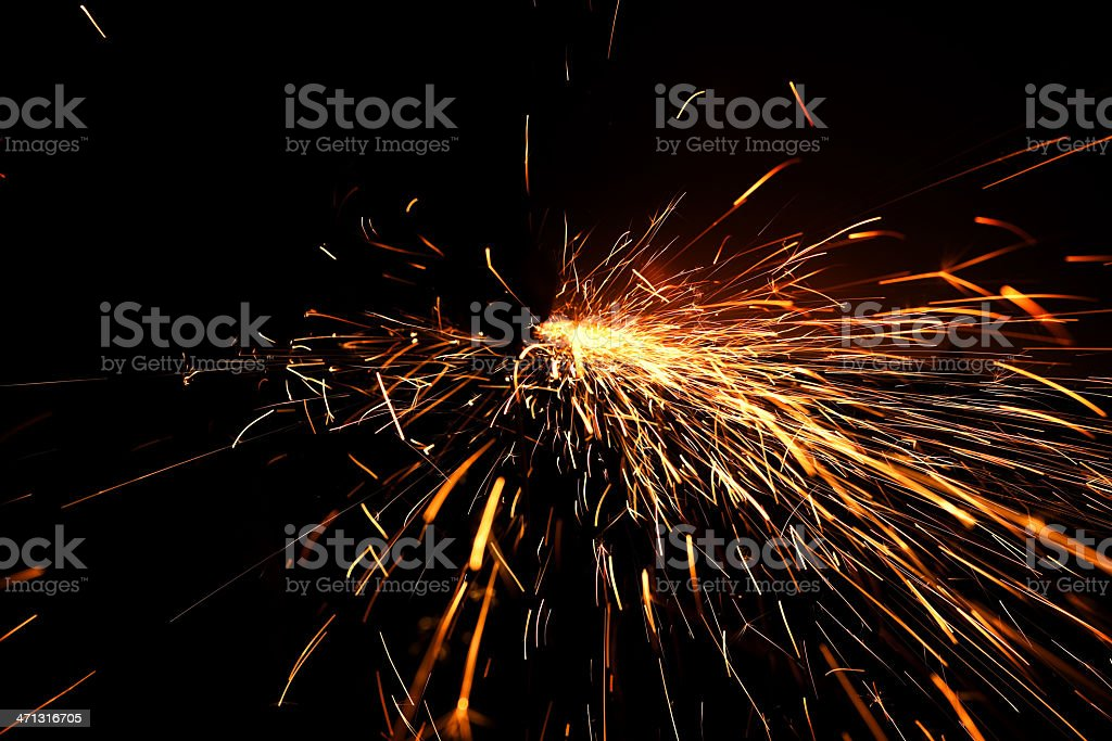 Sparks created while cutting metal.