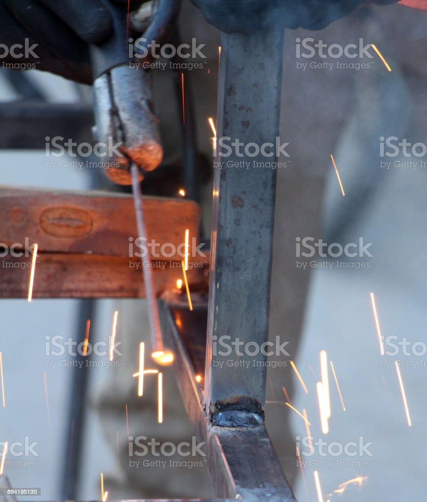 Sparks and jets of smoke when welding of steel structures royalty-free stock photo