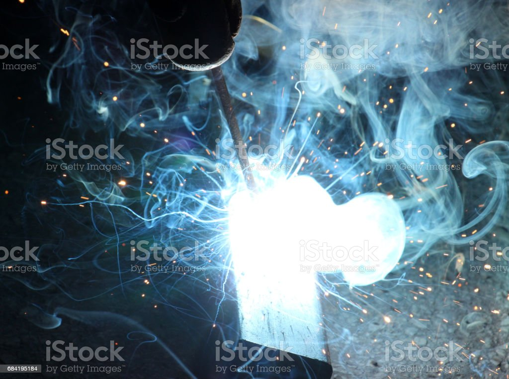 Sparks and jets of smoke when welding royalty-free stock photo