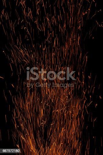 istock Sparks bonfire background 667572180