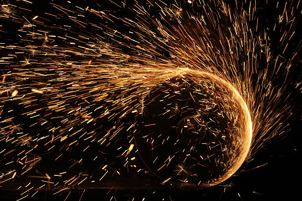 Sparks flying in a circular motion from welding stock photo