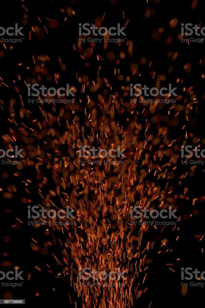 Sparks Flying Upward on Black Background stock photo