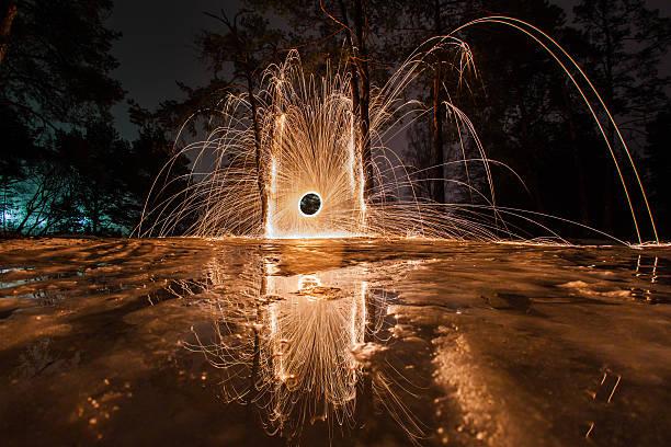 sparks from the burning steel wool in the spring forest - isvak bildbanksfoton och bilder