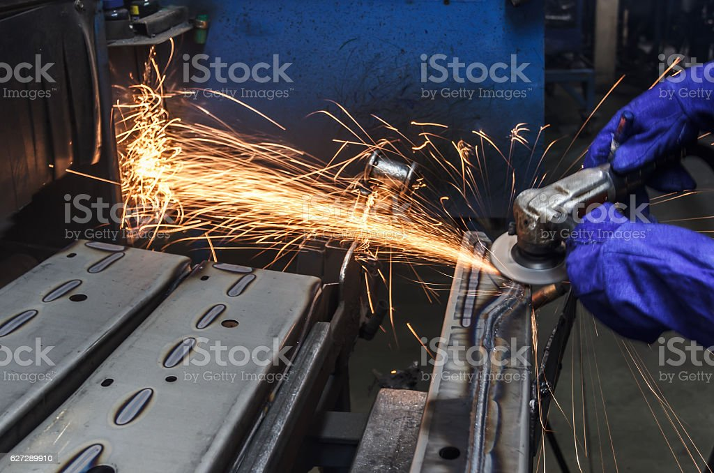 Sparks while grinding iron stock photo