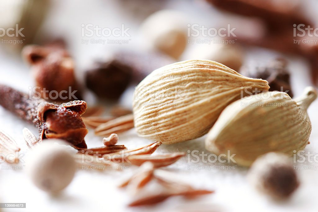 Sparse pieces of spices on a white fabric royalty-free stock photo