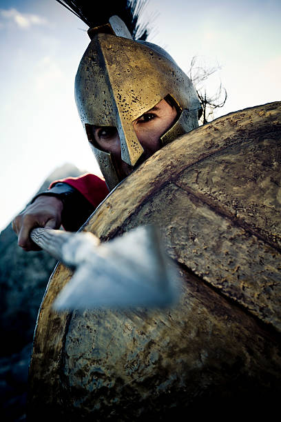 spartan in defense position - roman stock photos and pictures
