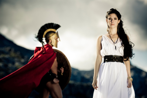 Portrait of spartan queen and spartan warrior with selfmade theater clothings,selective focus on her, very creative color retouching to underline the ancient time,vignetting, added noise,some areas with slightly overexposing