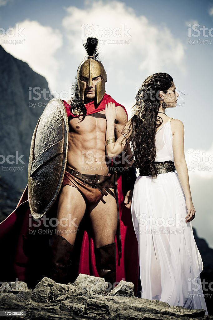 spartan warrior taking leave of his queen stock photo