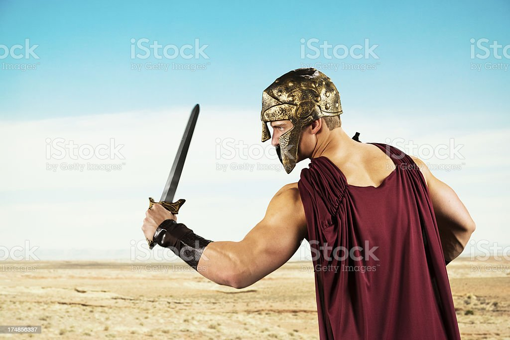 Spartan warrior with sword in battlefield royalty-free stock photo