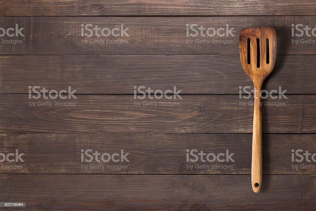 Spatula on the wooden background for you text stock photo