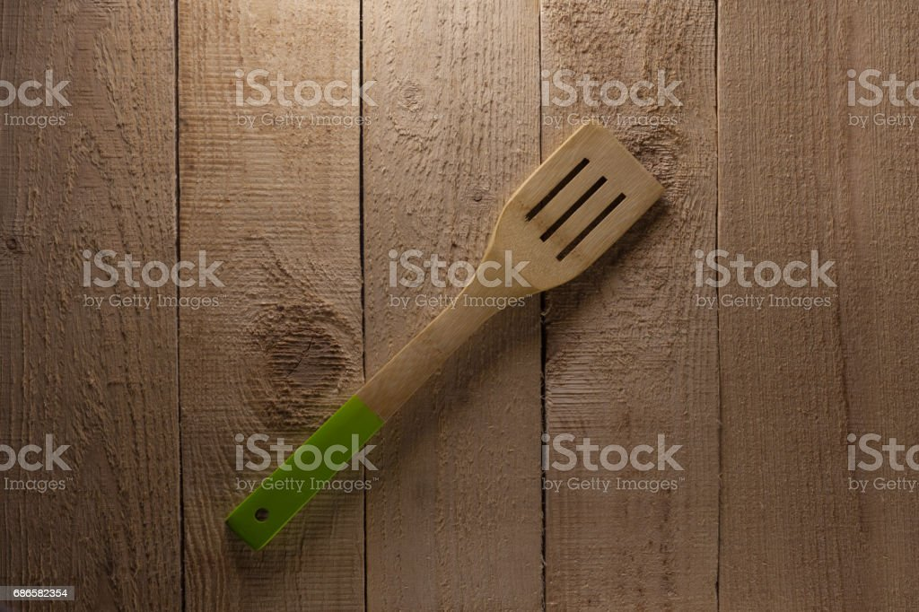 Spatula on the wooden background royalty-free stock photo