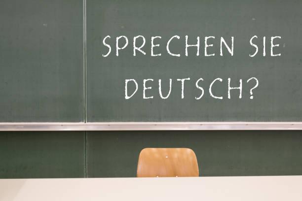 sprechen sie deutsch! - studieren in deutschland stock-fotos und bilder