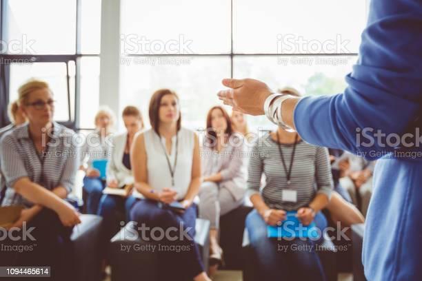 Speaker Addressing Group Of Females - Fotografias de stock e mais imagens de Adulto
