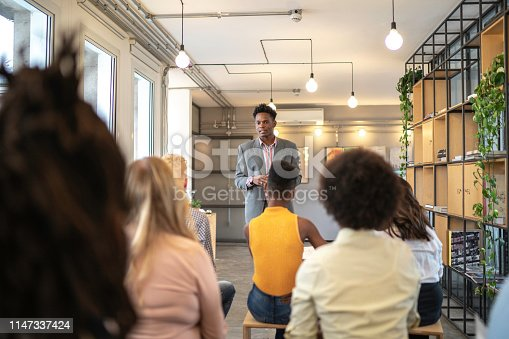 istock Speaker and audience at business convention and presentation 1147337424