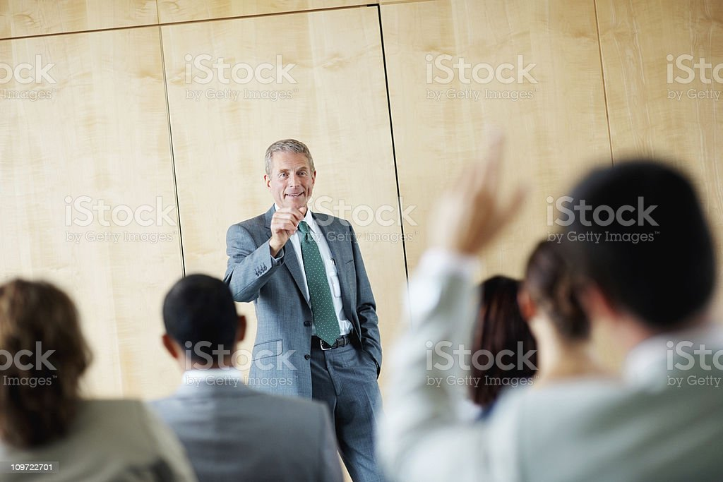 Speaker answering a question at  business seminar royalty-free stock photo
