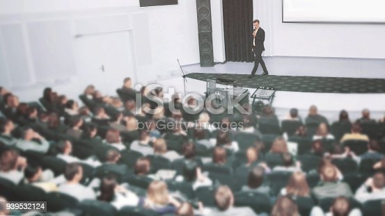 istock Speaker at a business convention and presentations. The audience on the large number of people 939532124