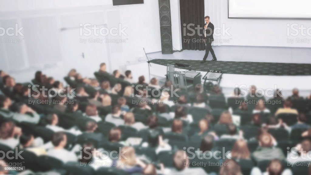 Speaker at a business convention and presentations. The audience on the large number of people stock photo