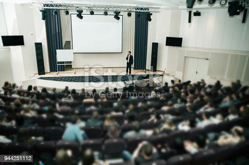 istock Speaker at Business Conference and Presentation. Audience the conference hall 944251112