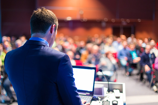 Speaker At Business Conference And Presentation Stock Photo - Download Image Now