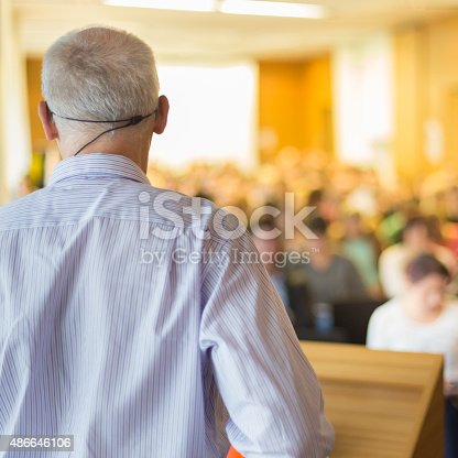 595328682 istock photo Speaker at Business Conference and Presentation. 486646106