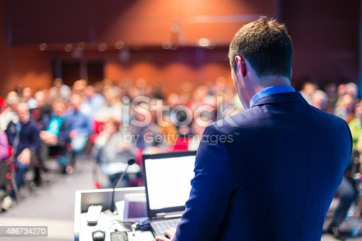 istock Speaker at Business Conference and Presentation. 486734270