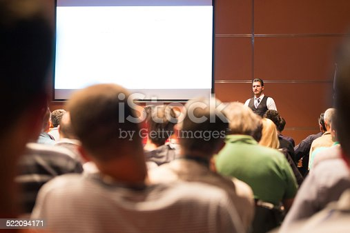 istock Speaker at Business Conference and Presentation. 522094171