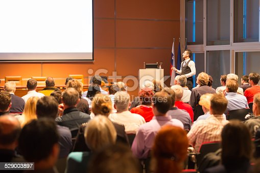 595328682 istock photo Speaker at Business Conference and Presentation. 529003897