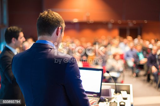 595328682 istock photo Speaker at Business Conference and Presentation. 533893794