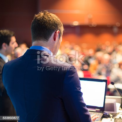 595328682 istock photo Speaker at Business Conference and Presentation. 533893822