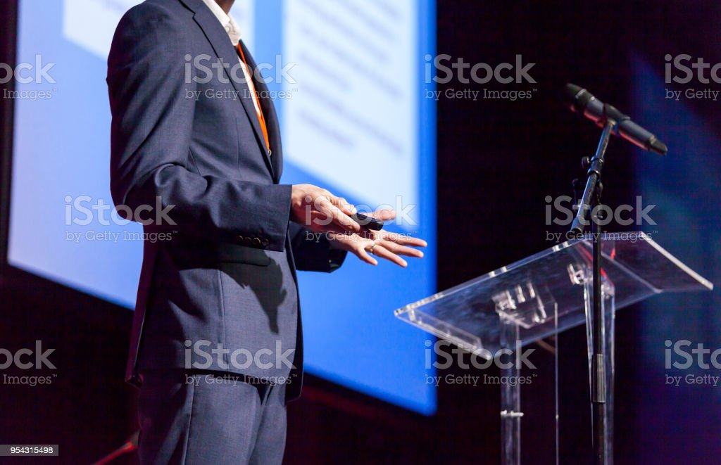 Speaker at business conference or presentation stock photo