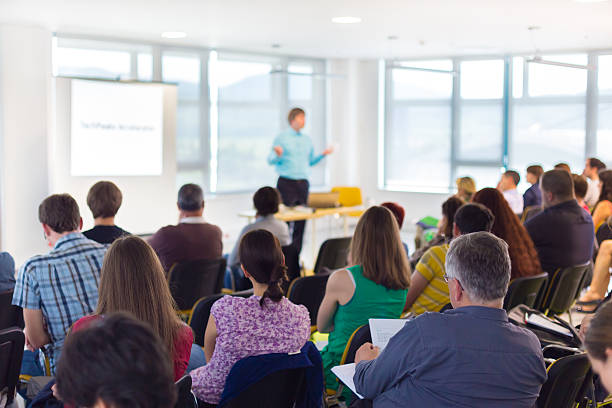 speaker at business convention and presentation. - classroom stock pictures, royalty-free photos & images
