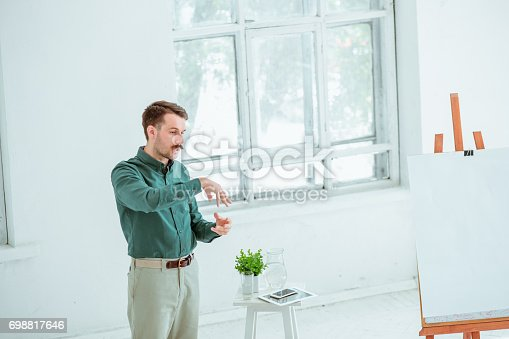 821463698 istock photo Speaker at Business Meeting in the conference hall 698817646