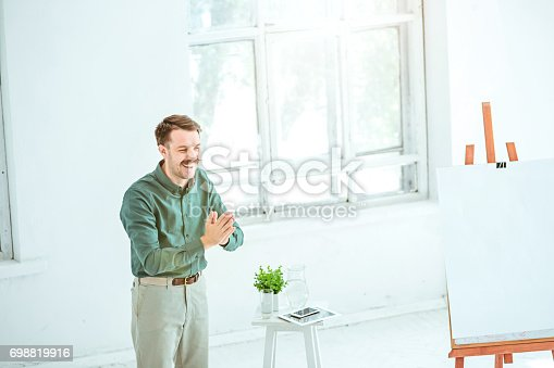 821463698 istock photo Speaker at Business Meeting in the conference hall 698819916