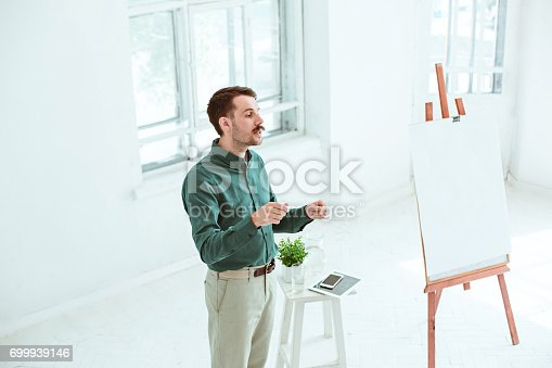 821463698 istock photo Speaker at Business Meeting in the conference hall 699939146