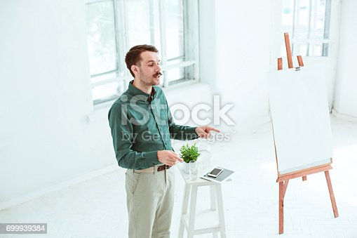 821463698 istock photo Speaker at Business Meeting in the conference hall 699939384